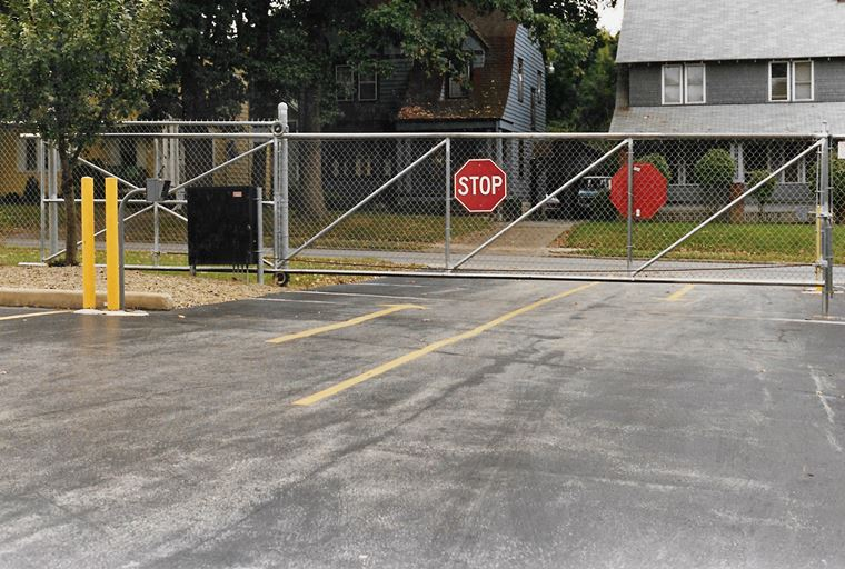 Gate operated electronically with stop sign